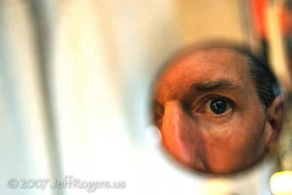 Jeff Rogers in small mirror